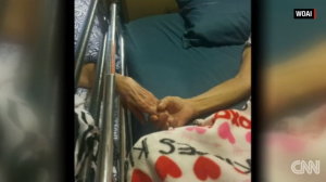 George and Ora Lee holding hands